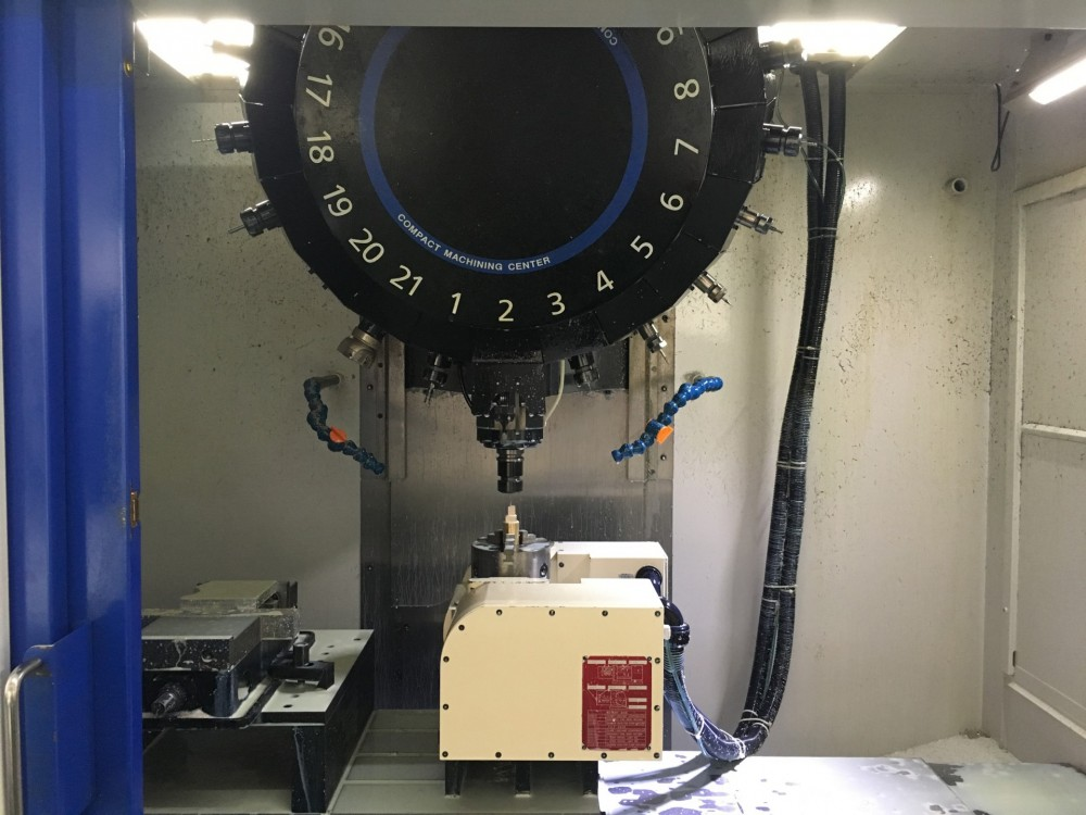 Four-axis CNC machining center